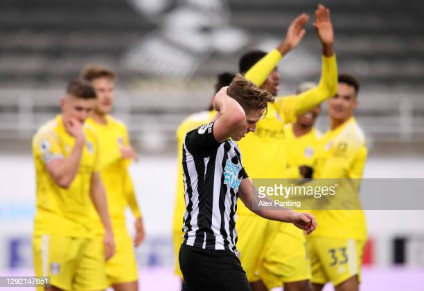 Matt Ritchie of Newcastle United looks dejected after scoring an own goal, the first goal for Fulham during the Premier League match between...