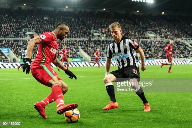 Matt Ritchie of Newcastle United looks to close down Jordan Ayew of Swansea City during the Premier League match between Newcastle United and Swansea...