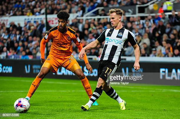Matt Ritchie of Newcastle United passes the ball whilst being guarded by Cameron BorthwickJackson of Wolverhampton Wanderers during the EFL Cup...