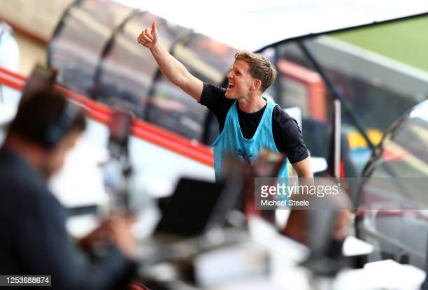 Matt Ritchie of Newcastle United reacts as he walks up to the stands and the area for substitute players prior to the Premier League match between...