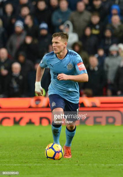 Matt Ritchie of Newcastle United runs with the ball during the Premier League match between Stoke City and Newcastle United at Bet365 Stadium on...