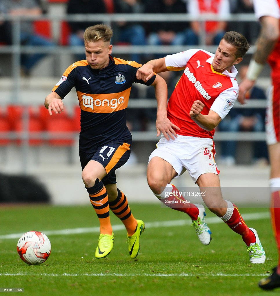 Matt Ritchie of Newcastle United (11) runs with the ball whilst being pursued by Will Vaulks of Rotherham United (4) during the Sky Bet Championship match between Rotherham United and Newcastle United at The New York Stadium on October 1, 2016 in Rotherham, England.