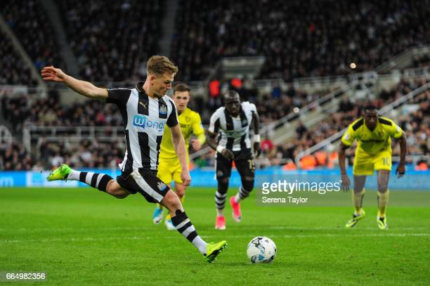 Matt Ritchie of Newcastle United scores a penalty which is disallowed during the Sky Bet Championship Match between Newcastle United and Burton...