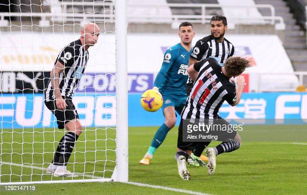 Matt Ritchie of Newcastle United scores an own goal, the first goal for Fulham during the Premier League match between Newcastle United and Fulham at...