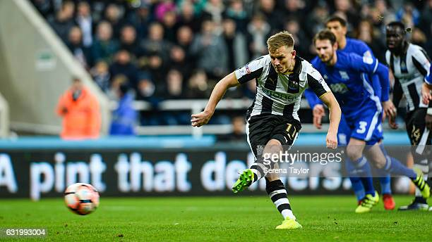 Matt Ritchie of Newcastle United scores from the penalty spot during the Emirates FA cup third round between Newcastle United and Birmingham City at...