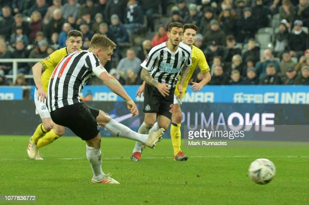 Matt Ritchie of Newcastle United scores his team's first goal from the penalty spot during the FA Cup Third Round match between Newcastle United and...