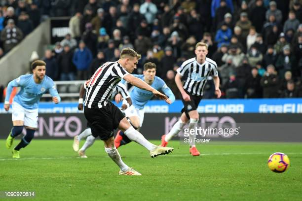 Matt Ritchie of Newcastle United scores his team's second goal from the penalty spot during the Premier League match between Newcastle United and...