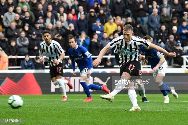 Matt Ritchie of Newcastle United shoots from a penalty which is saved by Jordan Pickford of Everton during the Premier League match between Newcastle...