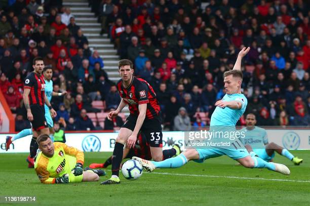 Matt Ritchie of Newcastle United stretches for the baduring the Premier League match between AFC Bournemouth and Newcastle United at Vitality Stadium...