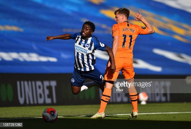 Matt Ritchie of Newcastle United tackles Tariq Lamptey of Brighton and Hove Albion during the Premier League match between Brighton & Hove Albion and...