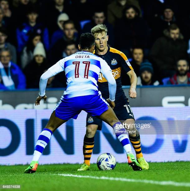 Matt Ritchie of Newcastle United takes on Jordan Obita of Reading during the Sky Bet Championship Match between Reading and Newcastle United at the...