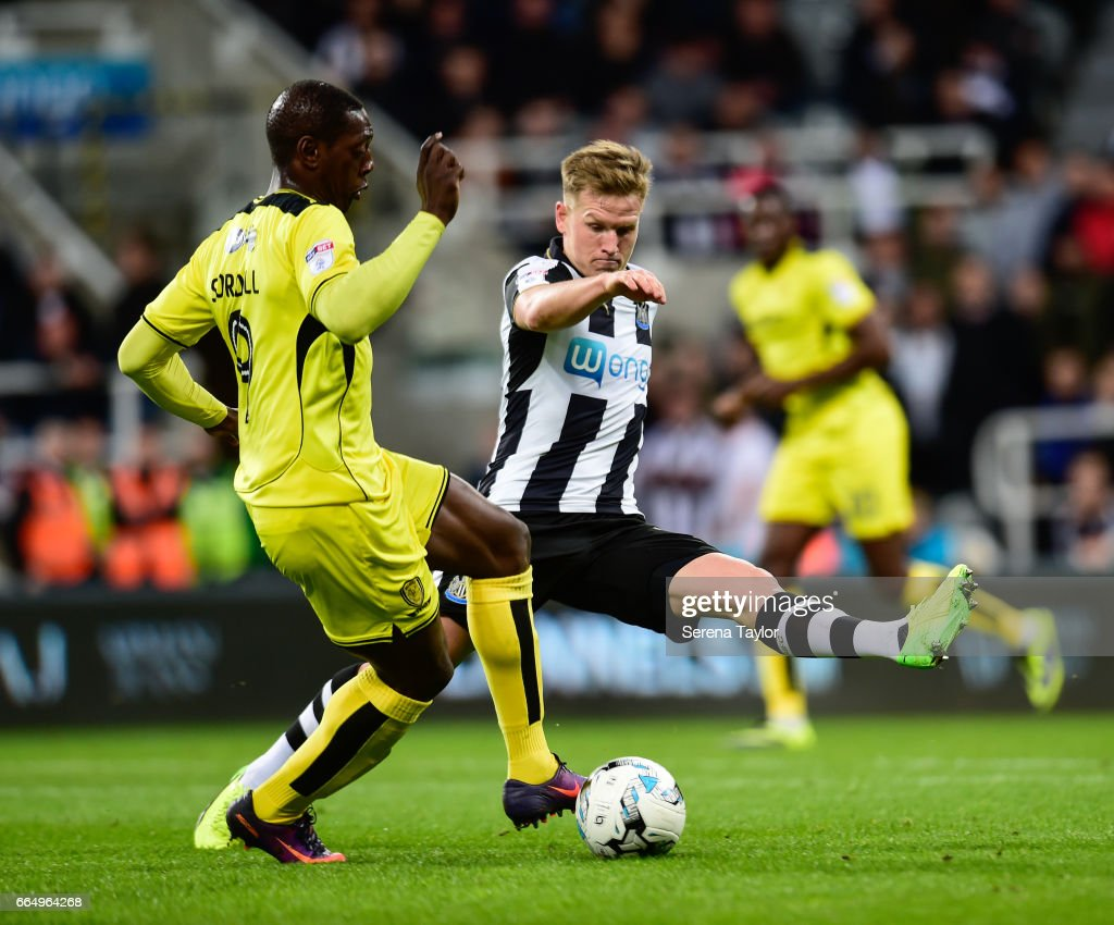 Matt Ritchie of Newcastle United (11) to close down Marvin Sordell of Burton Albion (9) during the Sky Bet Championship Match between Newcastle United and Burton Albion at St.James' Park on April 5, 2017 in Newcastle upon Tyne, England.