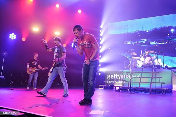 Matt Roberts Todd Harrell Brad Arnold and Greg Upchurch of 3 Doors Down perform at Hard Rock Live in the Seminole Hard Rock Hotel Casino on June 12...