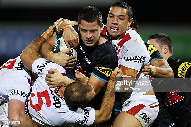 Matt Robinson of the Panthers is tackled by the Dragons defence during the round 16 NRL match between the Penrith Panthers and the St George...
