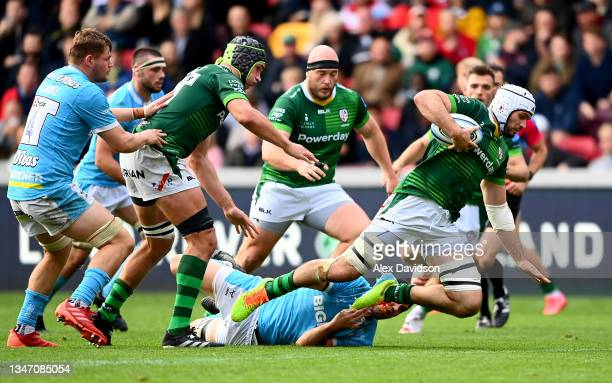 Matt Rogerson of London Irish is tackled by Santiago Carreras of Gloucester during the Gallagher Premiership Rugby match between London Irish and...