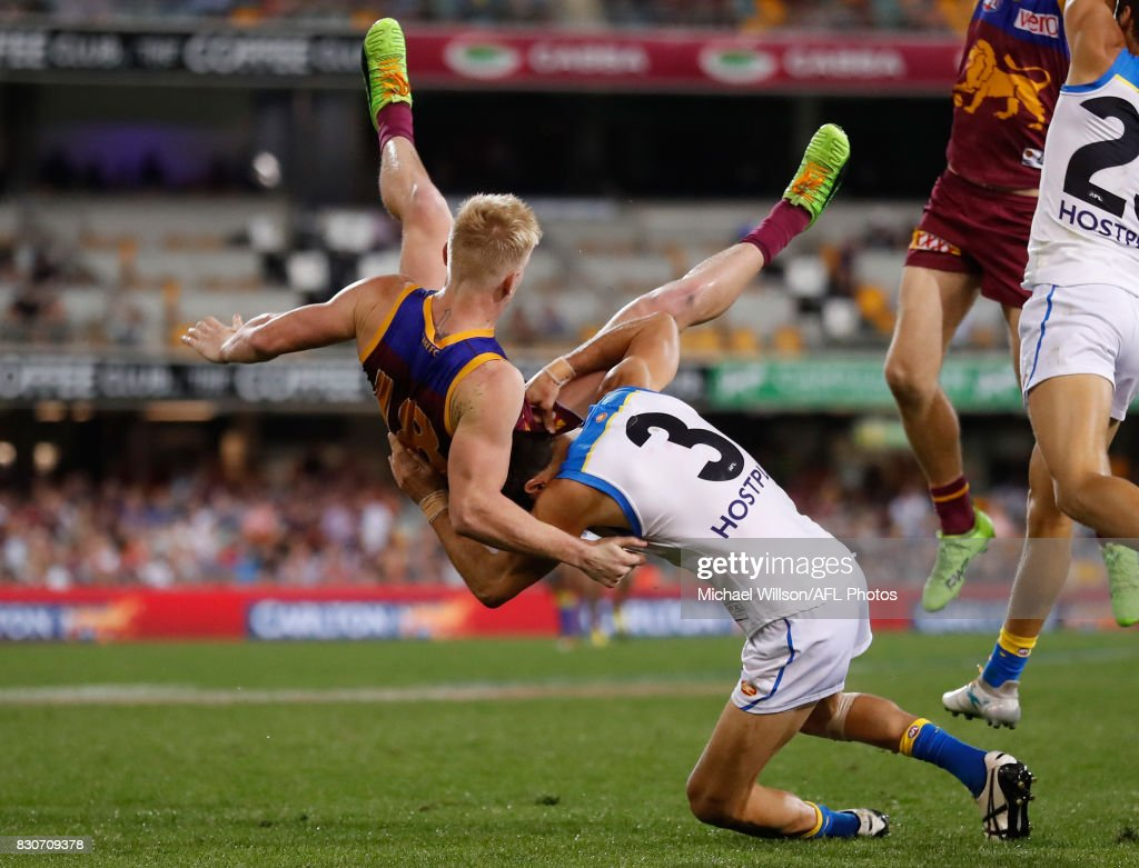 Matt Rosa of the Suns and Nick Robertson of the Lions collide during the 2017 AFL round 21 match between the Brisbane Lions and the Gold Coast Suns at the Gabba on August 12, 2017 in Brisbane, Australia.