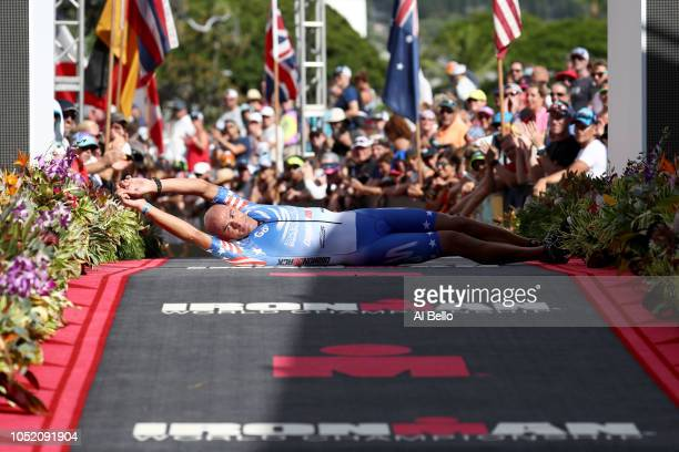 Matt Russell of the United States celebrates with a Blazeman roll after crossing the finish line during the IRONMAN World Championships brought to...