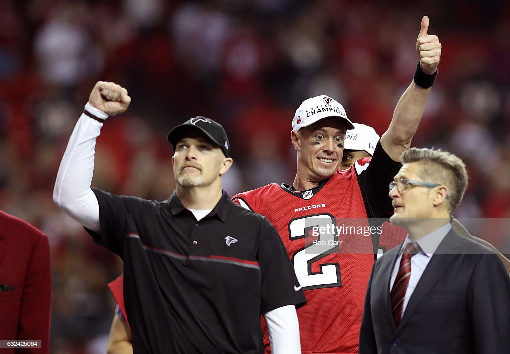 Matt Ryan #2 and head coach Dan Quinn of the Atlanta Falcons celebrate after defeating the Green Bay Packers in the NFC Championship Game at the Georgia Dome on January 22, 2017 in Atlanta, Georgia. The Falcons defeated the Packers 44-21.