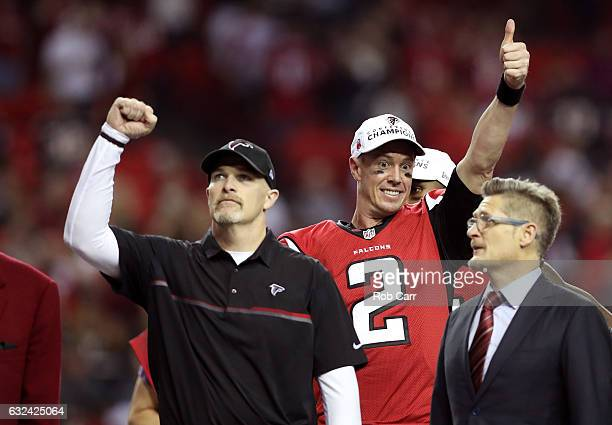 Matt Ryan and head coach Dan Quinn of the Atlanta Falcons celebrate after defeating the Green Bay Packers in the NFC Championship Game at the Georgia...