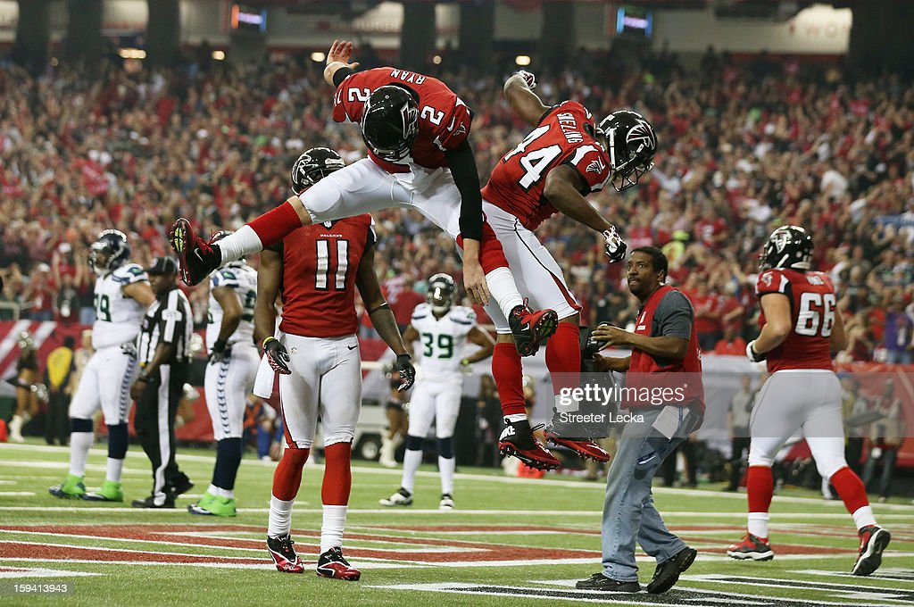 Matt Ryan #2 and Jason Snelling #44 of the Atlanta Falcons celebrate their third quarter touchdown against the Seattle Seahawks during the NFC Divisional Playoff Game at Georgia Dome on January 13, 2013 in Atlanta, Georgia.