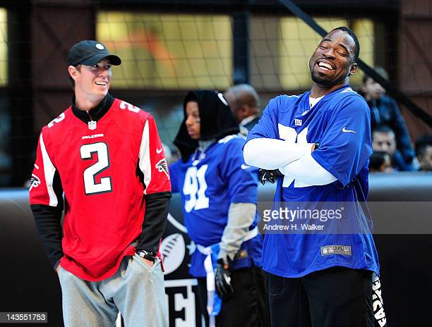 Matt Ryan and Justin Tuck attend Nike Brings Broadway Bowl Football Matchup To The Heart Of Times Square on April 27 2012 in New York City