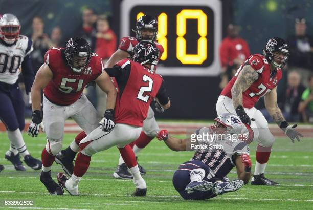 Matt Ryan of the Atlanta Falcons attempts to pass against Trey Flowers of the New England Patriots in the fourth quarter during Super Bowl 51 at NRG...