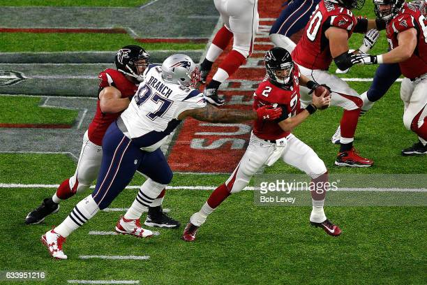 Matt Ryan of the Atlanta Falcons avoids the tackle of Alan Branch of the New England Patriots during the first quarter during Super Bowl 51 at NRG...