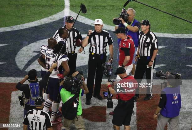Matt Ryan of the Atlanta Falcons awaits the overtime coin toss with Dont'a Hightower, Devin McCourty and Matthew Slater of the New England Patriots...
