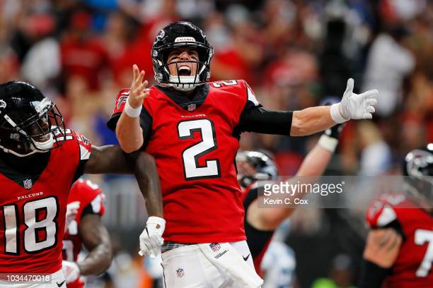 Matt Ryan of the Atlanta Falcons celebrates a rushing touchdown during the second half against the Carolina Panthers at Mercedes-Benz Stadium on...