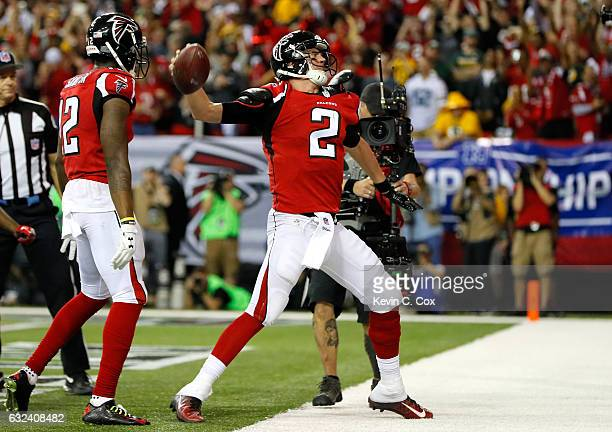 Matt Ryan of the Atlanta Falcons celebrates after running for a 14 yard touchdown in the second quarter against the Green Bay Packers in the NFC...