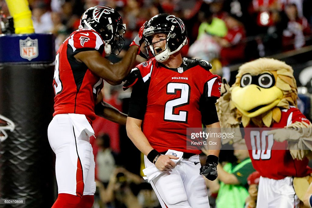 Matt Ryan #2 of the Atlanta Falcons celebrates with Aldrick Robinson #19 after a 14 yard touchdown run in the second quarter against the Green Bay Packers in the NFC Championship Game at the Georgia Dome on January 22, 2017 in Atlanta, Georgia.