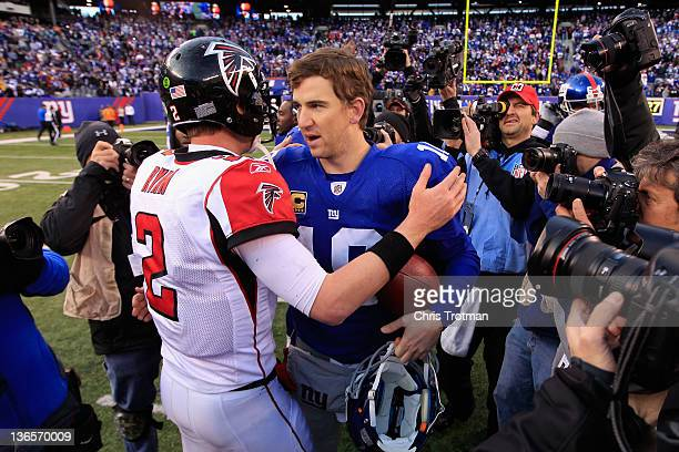 Matt Ryan of the Atlanta Falcons congratulates Eli Manning of the New York Giants after Manning and the Giants won 24-2 during their NFC Wild Card...