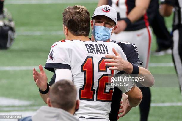 Matt Ryan of the Atlanta Falcons congratulates Tom Brady of the Tampa Bay Buccaneers on their win after the game at Mercedes-Benz Stadium on December...