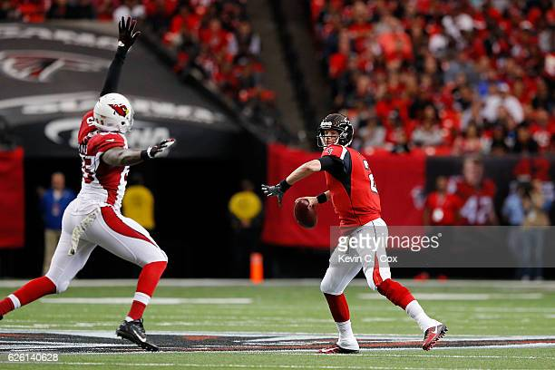 Matt Ryan of the Atlanta Falcons drops back to pass under pressure from Chandler Jones of the Arizona Cardinals during the first half at the Georgia...