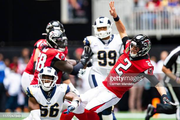 Matt Ryan of the Atlanta Falcons falls after pressure from defender Dante Fowler of the Los Angeles Rams during the first half of a game at...