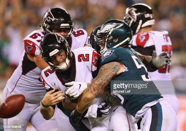 Matt Ryan of the Atlanta Falcons fumbles the ball as he is hit by Chris Long of the Philadelphia Eagles during the fourth quarter at Lincoln...