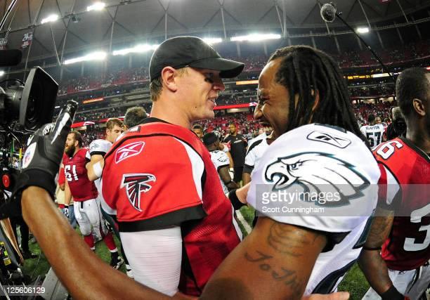Matt Ryan of the Atlanta Falcons greets Asante Samuel of the Philadelphia Eagles after the game at the Georgia Dome on September 18 2011 in Atlanta...