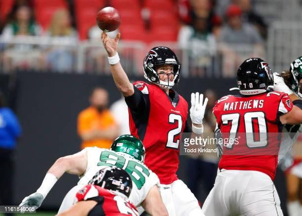 Matt Ryan of the Atlanta Falcons is pressured as he releases the ball during the first half of an NFL preseason game against the New York Jets at...