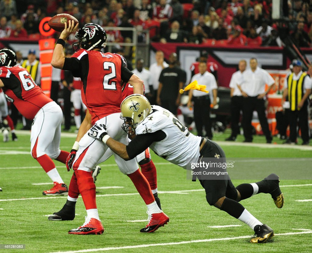 Matt Ryan #2 of the Atlanta Falcons is pressured by Cameron Jordan #94 of the New Orleans Saints at the Georgia Dome on November 21, 2013 in Atlanta, Georgia.