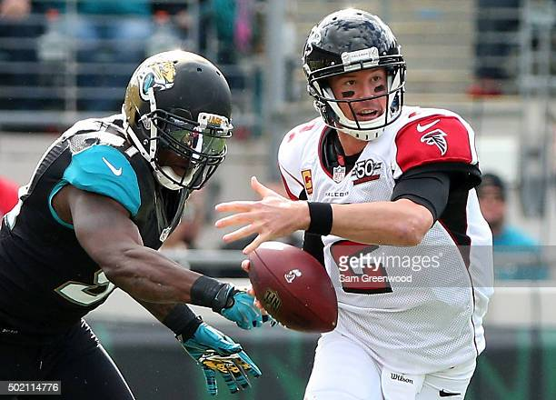 Matt Ryan of the Atlanta Falcons is pressured by Chris Clemons of the Jacksonville Jaguars during the game at EverBank Field on December 20 2015 in...