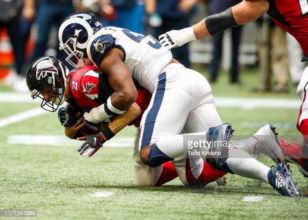 Matt Ryan of the Atlanta Falcons is sacked by Dante Fowler of the Los Angeles Rams Rams in the second half of an NFL game at Mercedes-Benz Stadium on...