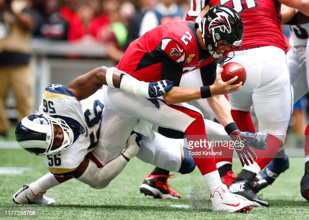 Matt Ryan of the Atlanta Falcons is sacked by Dante Fowler of the Los Angeles Rams in the first half of an NFL game at Mercedes-Benz Stadium on...