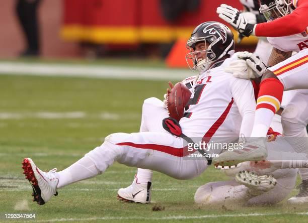 Matt Ryan of the Atlanta Falcons is sacked by Frank Clark of the Kansas City Chiefs during the third quarter at Arrowhead Stadium on December 27,...