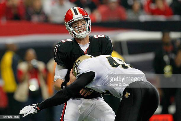 Matt Ryan of the Atlanta Falcons is sacked by Roman Harper of the New Orleans Saints at Georgia Dome on November 13 2011 in Atlanta Georgia
