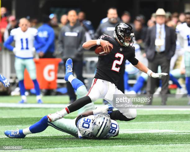 Matt Ryan of the Atlanta Falcons is sascked in the second quarter by Demarcus Lawrence of the Dallas Cowboys at MercedesBenz Stadium on November 18...
