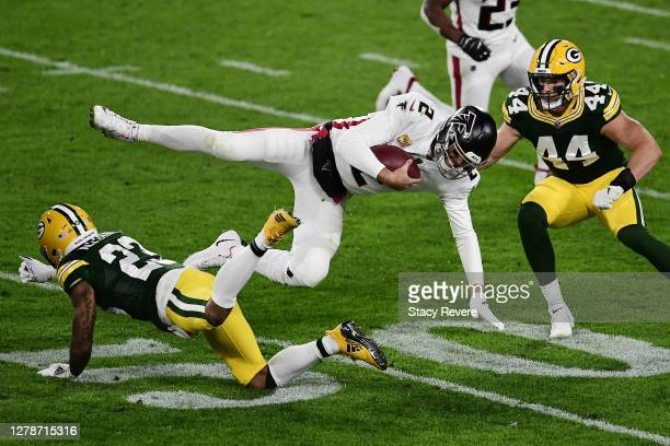 Matt Ryan of the Atlanta Falcons is tackled by Jaire Alexander of the Green Bay Packers during the second half at Lambeau Field on October 05, 2020...