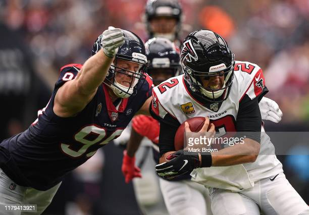 Matt Ryan of the Atlanta Falcons is tackled by J.J. Watt of the Houston Texans in the second quarter at NRG Stadium on October 06, 2019 in Houston,...