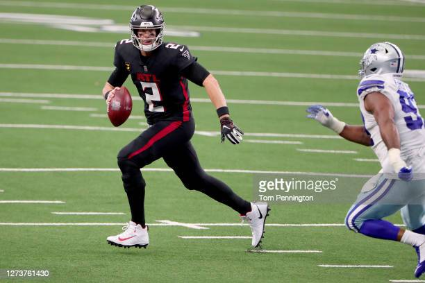 Matt Ryan of the Atlanta Falcons looks for an open receiver against the Dallas Cowboys in the second half at AT&T Stadium on September 20, 2020 in...