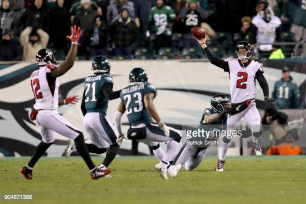 Matt Ryan of the Atlanta Falcons looks to throw the ball to Mohamed Sanu against the Philadelphia Eagles during the third quarter in the NFC...