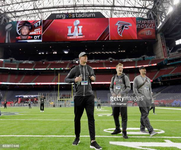 Matt Ryan of the Atlanta Falcons Matt Schaub and Matt Simms#4 walk on the turf during the Super Bowl LI team walk through at NRG Stadium on February...